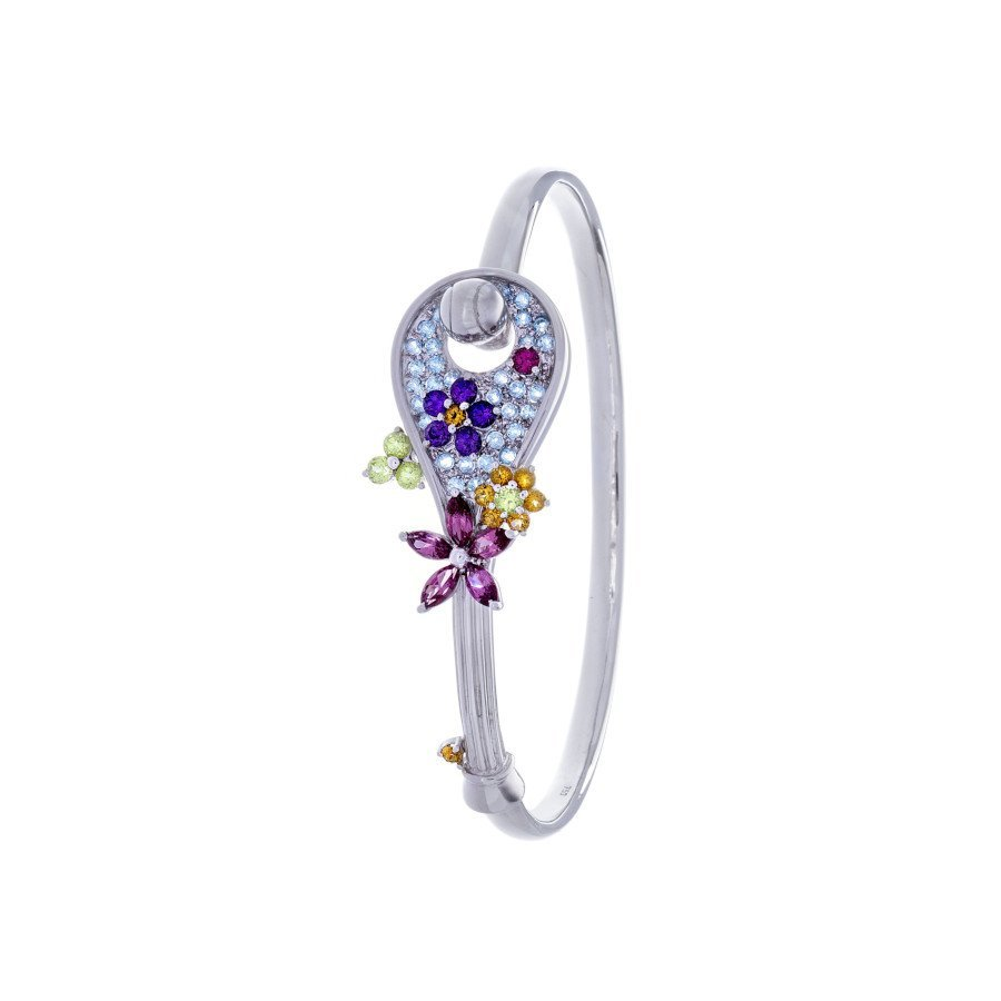 Tennis jewelry consisting of gemtique tennis racket bracelet (18K white gold with 58 gemstones)